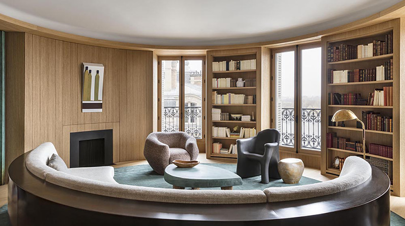 library in a house with a curving sofa