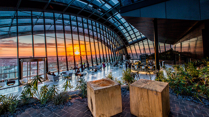 sun setting over london view from sky garden
