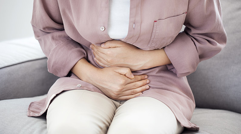 A woman with stomach cramps