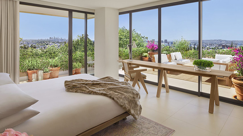 hotel with floor to ceiling windows that feature stunning views of Los Angeles or the Hollywood Hills.