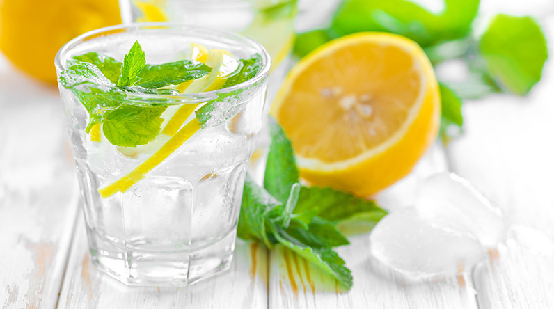 Glass of water with lemon and mint / Shutterstock