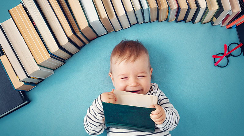 Baby with books / Shutterstock