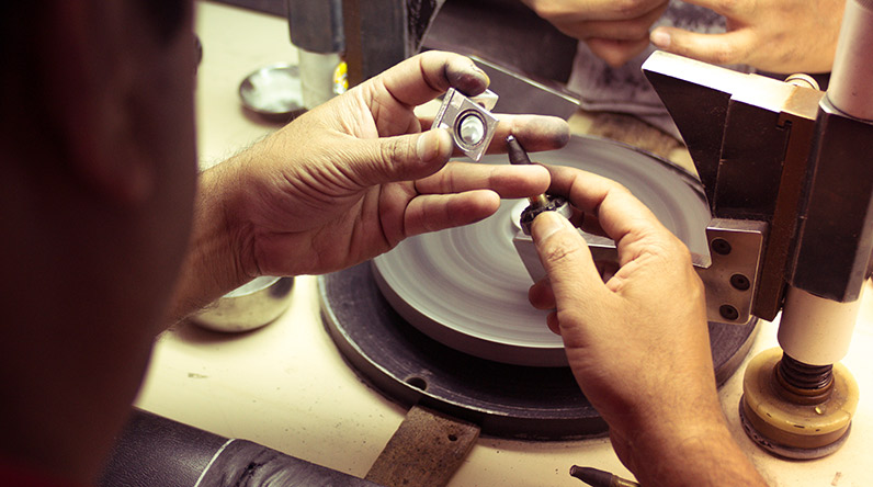 Artisan making jewellery at The Gem Palace