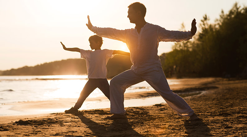 Father and son practicing Tai Chi / Shutterstock