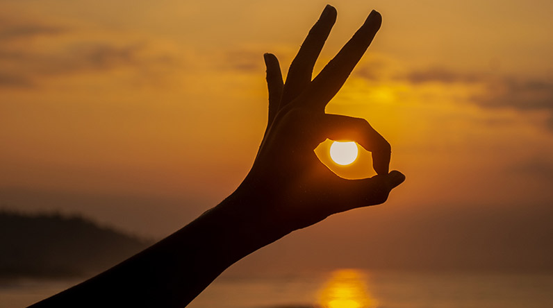 Hand with sunset inside