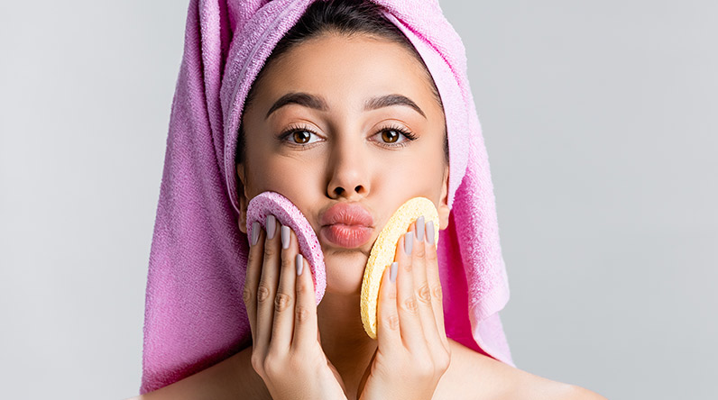 Woman cleansing face / Shutterstock