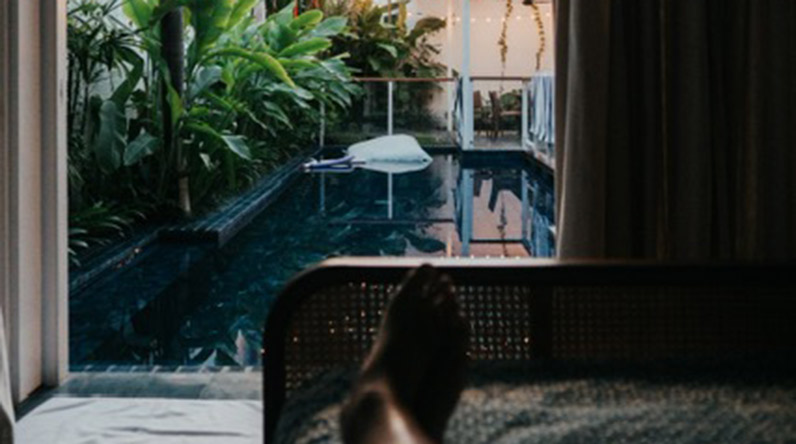 Woman relaxing looking at pool