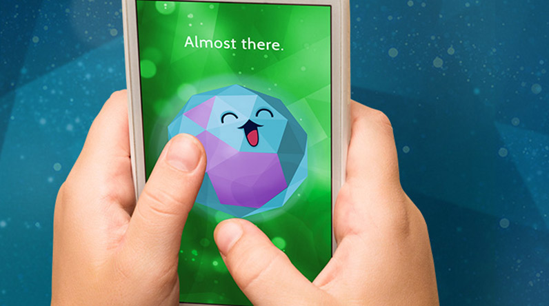 Child playing with the Mindful Powers app